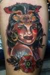 pin up girl tattoo, wolf head dress