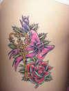 skelton key on ribs tattoo