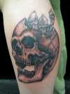 skull and creatures tattoo