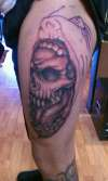 Skull With face not finished tattoo