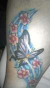 Butterfly and flowers in the wind. tattoo