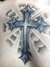 unique cross in heaven tattoo