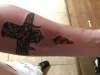 Cross Skin Tear tattoo