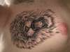 Lion head chest tattoo