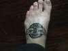 Winged emblem tattoo