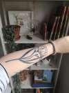 Blackwork freesias tattoo