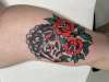 Black sheep with roses tattoo
