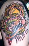 snake and leg tatt tattoo