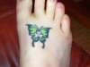 Butterfly with clover tattoo