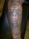 Black and gray face tattoo