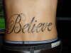 lower back BELIEVE tattoo