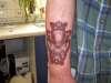 Skull/celtic - (scar cover up) tattoo