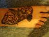 Hummingbird and 2 Roses tattoo