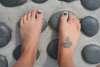 Cross on foot tattoo