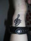 treble/bass clef tattoo