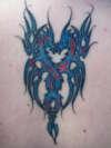 Intertwined Dragons tattoo