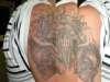 Aztec styled skulls tattoo