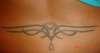 Lower back tatt tattoo