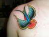 Swallow (1st of 2) tattoo