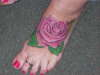 Rose on the foot tattoo
