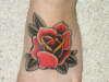 Rose on Left foot tattoo