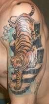 tiger arm piece tattoo