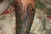 Skulls and flames tattoo