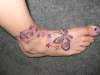 butterfly and shooting stars on foot and ankle tattoo