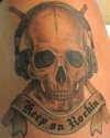Keep on Rockin Skull tattoo