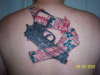 Gun taped to back with xmas tape tattoo