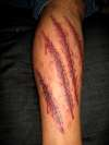 wounded skin tattoo