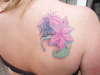 Flower and butterfly cover up tattoo