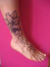 Stargazer Lily Ankle & Foot Tattoo