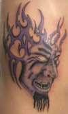 Tribal nugget head tattoo