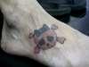 pink skull tattoo