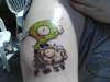Gir on a skeleton piggy the day after tattoo