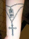 beads, dogtag and cross tattoo