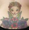Lower back cover-up tattoo